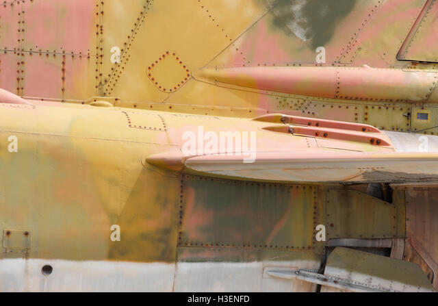 Fighter aircraft rusty fuselage detail in horizontal format - Stock Image
