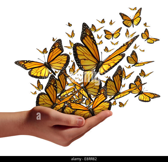 Hope and freedom concept as a human hand releasing a group of butterflies as a symbol for education communication - Stock Image