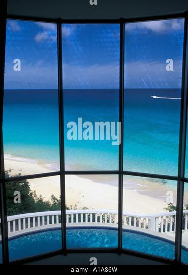 Anguilla beach view from suite window at Malliouhana luxury resort villa - Stock Image