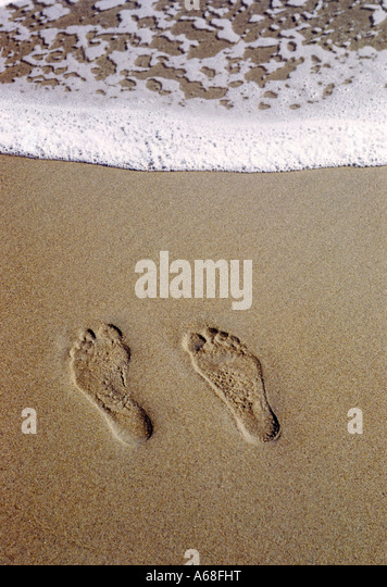 Foot prints in the sand - Stock Image