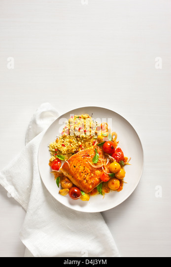 Arctic Char with Blistered Cherry Tomatoes, with Sweet Pepper Couscous with Pine Nuts - Stock Image