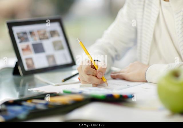 Boy using digital tablet and doing homework, Osijek, Croatia, Europe - Stock Image