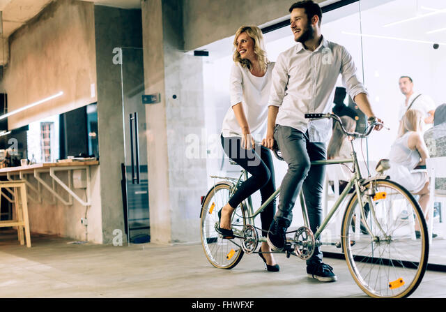 Business in motion, partnership represented by twin bicycle - Stock Image