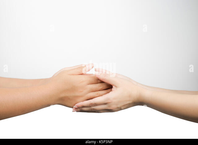 Closeup young Asian woman pay respect to senior people - Stock Image