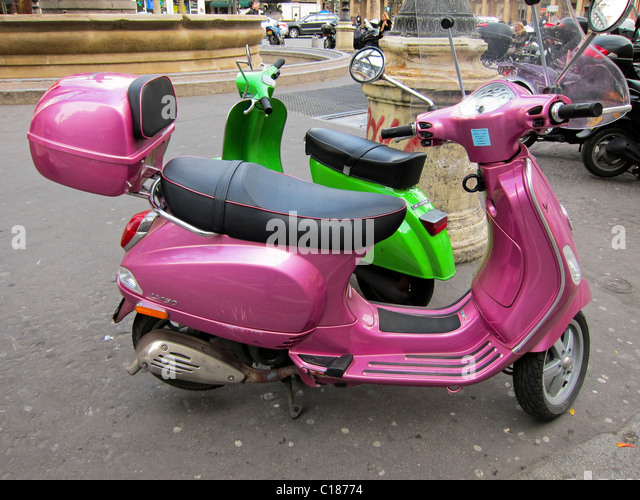 Pink vespa scooter stock photos pink vespa scooter stock for Motor scooter blue book