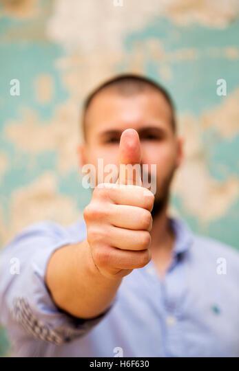 Man showing thumb up okay sign - Stock Image