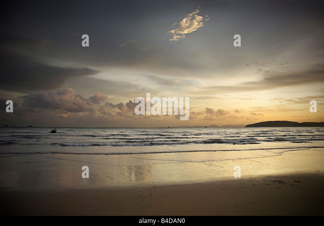 Sunset, looking towards Phuket Island, Ao Nang Beach, Ao Nang, Krabi, Thailand. - Stock Image