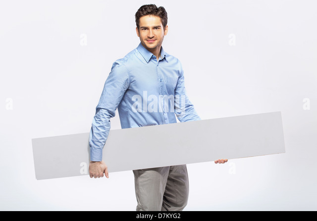 Picture of handsome guy in suit with a blank board - Stock Image