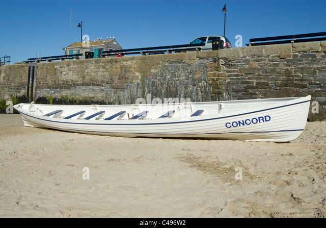 Concord, a fibreglass gig uses for training by the Newquay rowing club in Cornwall UK. - Stock Image