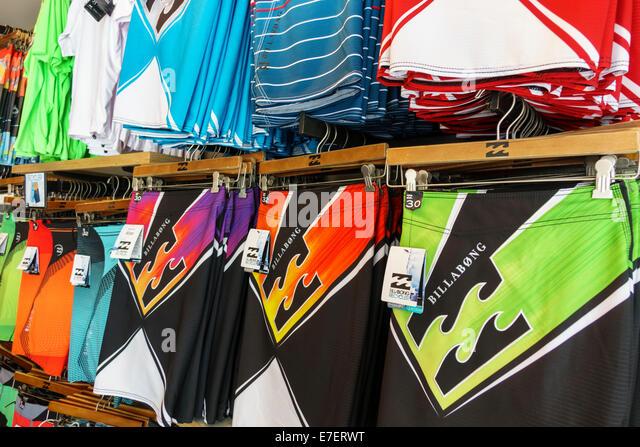 Hawaii Hawaiian Oahu Honolulu Waikiki Beach Kalakaua Avenue shopping swimming trunks fashion Billabong - Stock Image