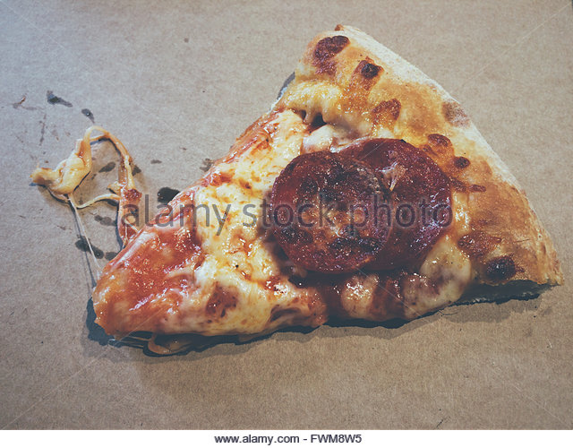 High Angle View Of Pizza On Table - Stock Image