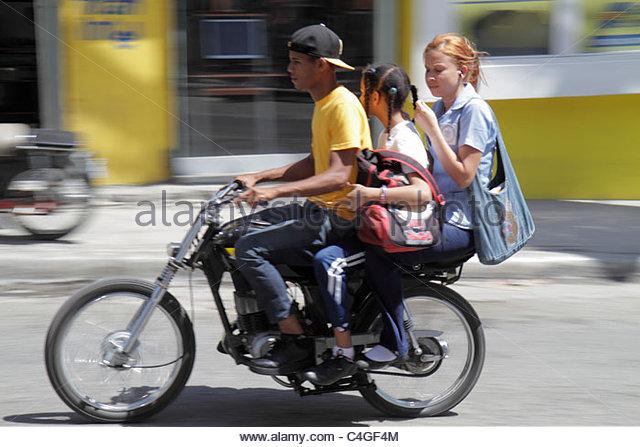 Santo Domingo Dominican Republic Bajos de Haina motorcycle taxi motoconcho public transportation business self-employment - Stock Image