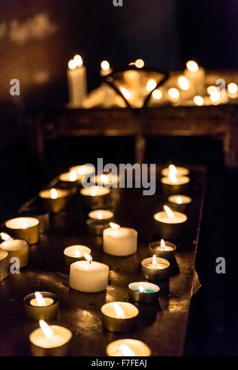 Votive candles in a catholic church. - Stock-Bilder