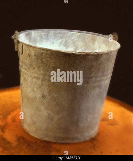 Old corroded galvanized Tin Bucket - Stock Image