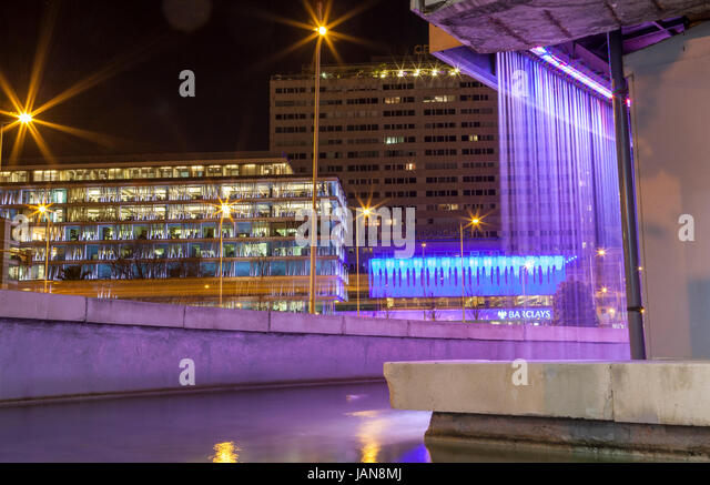 Madrid, Spain - ferbruary 24, 2017: Colon Square from Fernan Gomez art centre fountain at night - Stock Image