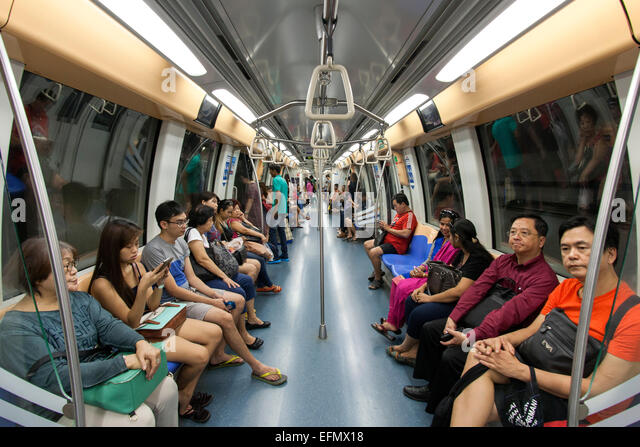 Interior of a carriage of the Singapore MRT (Mass Rapid Transit) system. - Stock Image