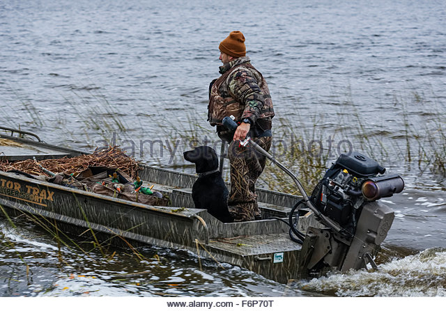 Duck hunter and his dog, Northern Michigan - Stock Image