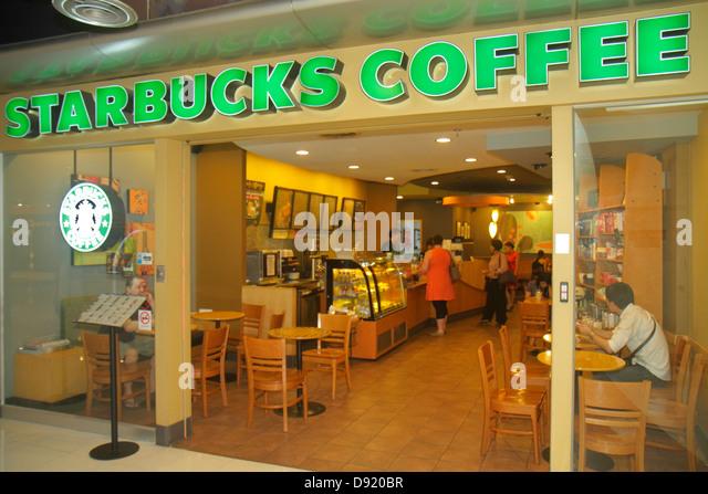 Thailand Bangkok Pathum Wan Rama 1 Road MBK Center centre complex mall shopping Starbucks Coffee cafe front entrance - Stock Image