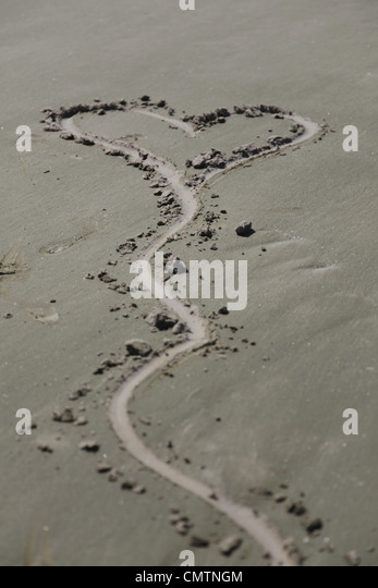 High angle view of heart shape on sand - Stock Image