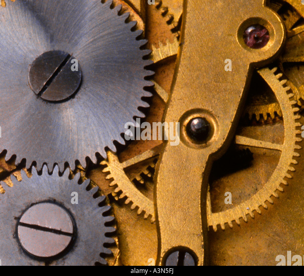 Clock Interior Gears Detail Close-up Working Mechanical Parts Sandra Baker - Stock Image