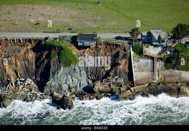 aerial above house ready to fall into the Pacific Ocean along Highway One in Sonoma County, California - Stock-Bilder