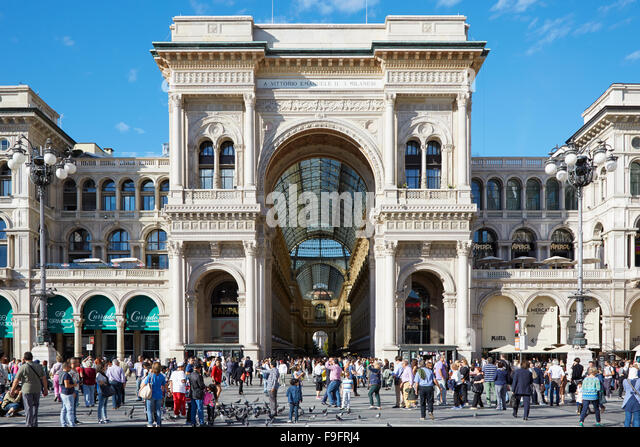 Milan Vittorio Emanuele gallery exterior view with people in a sunny day - Stock Image