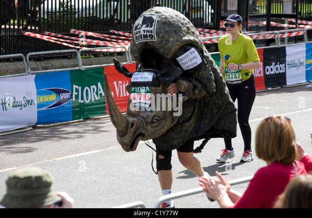 man in rhino costume running in the London marathon - Stock Image