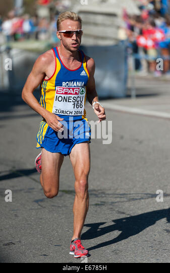 Zurich, Switzerland. 17th Aug, 2014. Marius Ionescu (ROU) on the steep and difficult track of the men's marathon - Stock Image