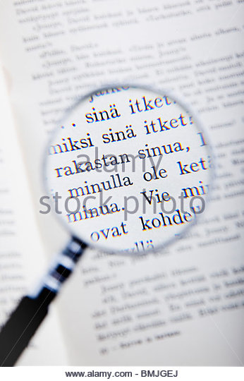 Magnified text with enlarger - Stock Image