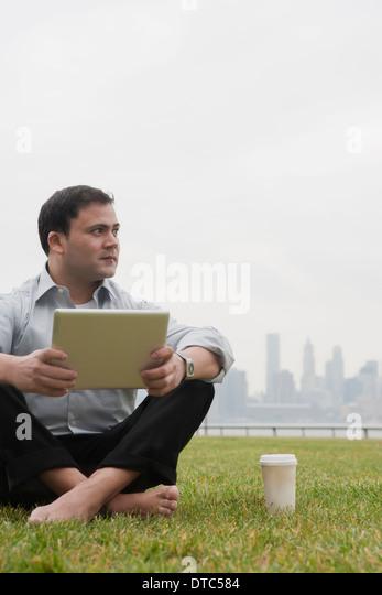 Businessman using laptop, Hoboken, New Jersey, USA - Stock-Bilder