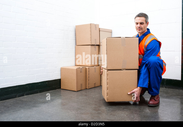 MODEL RELEASED Correct lifting posture - Stock Image