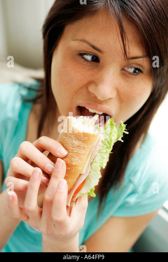 Teenager eating healthy sandwich - Stock-Bilder