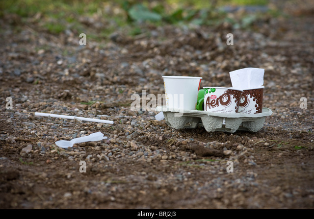 Fast food rubbish dumped in a country lane - Stock Image