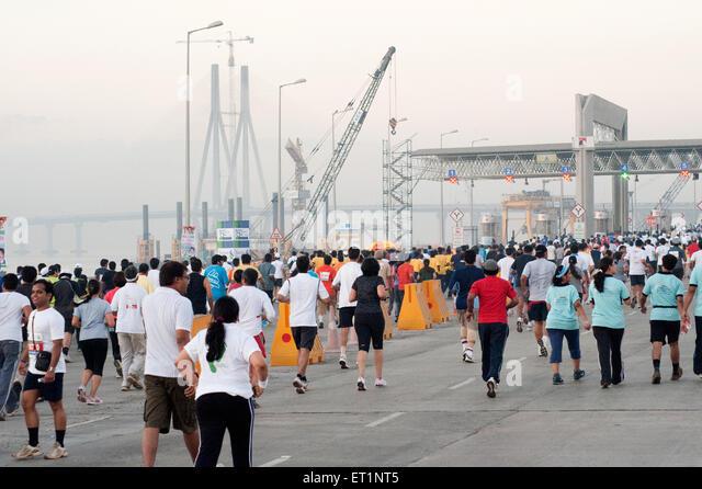 Marathon runners on sea link ; Bombay Mumbai ;  Maharashtra ; India NOMR - Stock Image