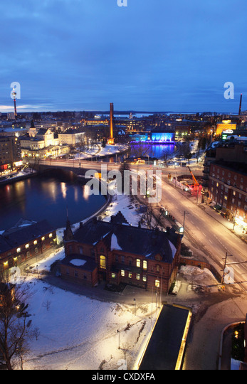 River Tammerkoski runs past the Finlayson Complex, the Nasinneula tower (top left), city centre of Tampere, Pirkanmaa, - Stock Image