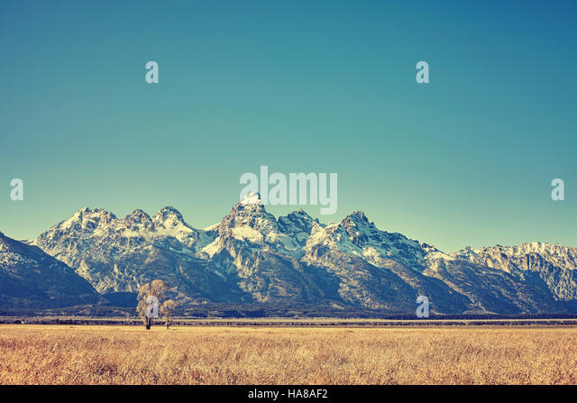 Retro toned view of Grand Teton mountain range, Wyoming, USA. - Stock Image