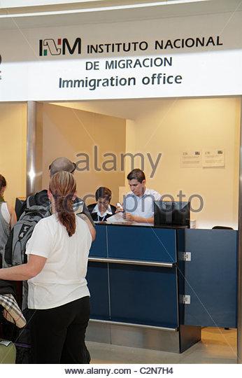 Cancun Mexico Yucatán Peninsula Quintana Roo Cancun International Airport Hispanic man woman immigration office - Stock Image