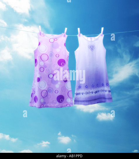two dresses on a washing line - Stock Image
