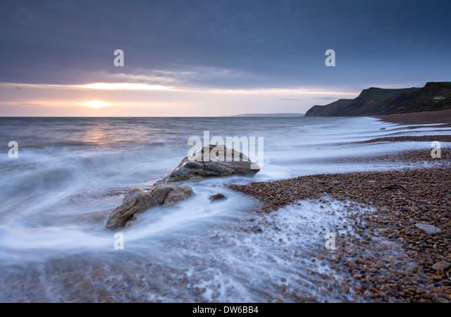 Winter sunset over Eype Beach on the Jurassic Coast, Dorset, England. Winter (January) 2014. - Stock Image