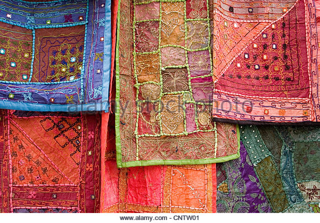 Ornate tapestries hanging together - Stock Image