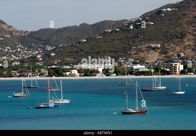 Sint Maarten Great Bay Philipsburg Dutch boats sailboats mountains buildings - Stock Image
