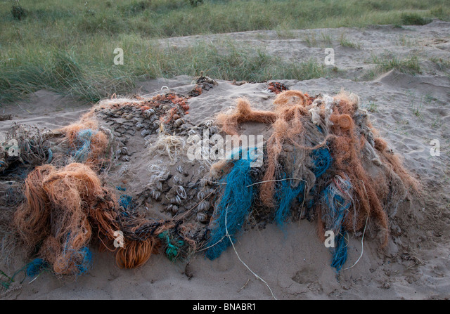 Abandoned nets on a Lincolnshire beach. - Stock Image