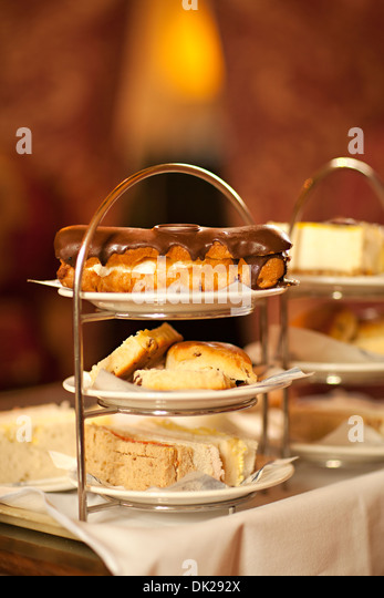 Close up of pastry desserts on cake tiers - Stock Image