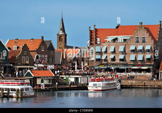 Netherlands, Edam-Volendam, View of the harbor, and the Reformed Church Spire in the background. - Stock Image