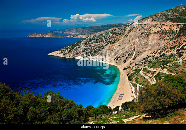 World famous Myrtos beach in Kefalonia island. In the background in that small peninsula you can see Assos village. - Stock-Bilder