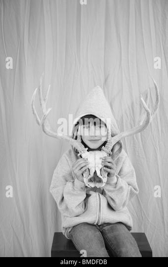 Young girl with animal skull - Stock-Bilder