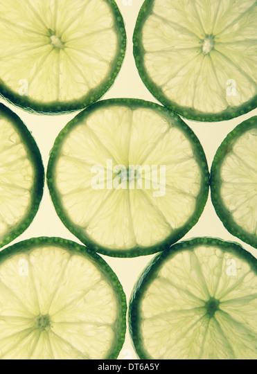 Organic lime slices on white background - Stock-Bilder