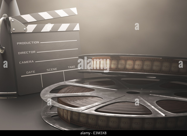 Clapperboard with rolls of film in the retro concept cinema. - Stock Image