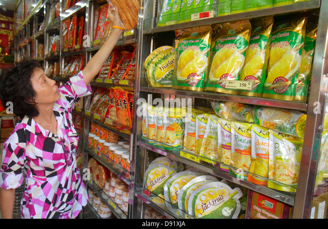 Bangkok Thailand Samphanthawong Chinatown Yaowarat Road Chinese gourmet food store Asian woman shopping selecting - Stock Image