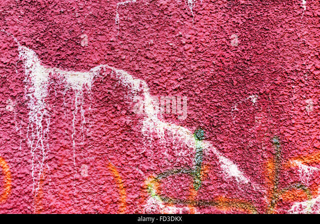 Authentic textured background old wall, hooligans stained with paint. Landscape style. Grungy concrete surface, - Stock Image
